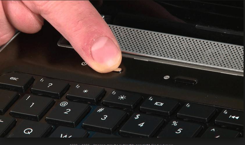 press the laptop power button